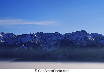 Remote mountains The Tatras in Poland above clouds