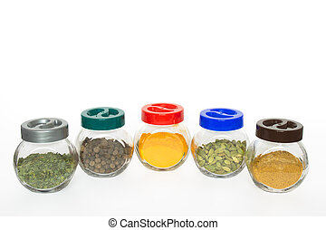 Jars with various exotic spices (fenugreek,allspice tree,...