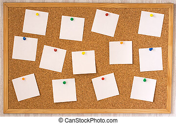 White notes on cork board - White notes pinned to cork board...