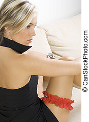 red garter - pretty blond girl in black dress and red garter...