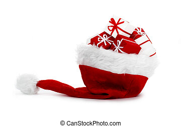 Santa hat - A red santa hat with gifts isolated on white...