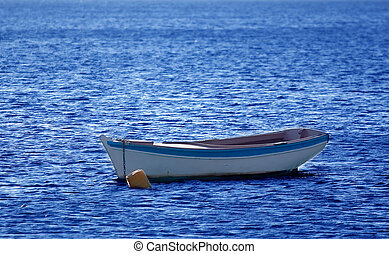 Old boat - A small wooden boat anchored in the bay