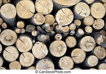 Pile of firewood - stacked wood logs of different sizes