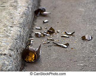 Shattered Dreams - A broken beer bottle on the edge of a...