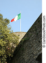 Italian Flag - Italian flag under blue sky on a historical...