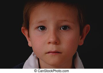Boy Low Key - Low key portrait of a young boy isolated on...