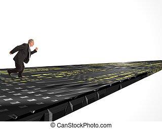 E Business - Businessman running along a computerized...