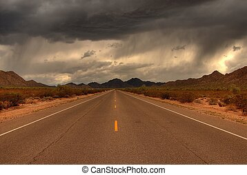 Desert Mountain Road - Dramatic desert mountain road with a...