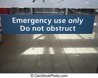 Emergency Exit - picture of a glass sliding door with a big...