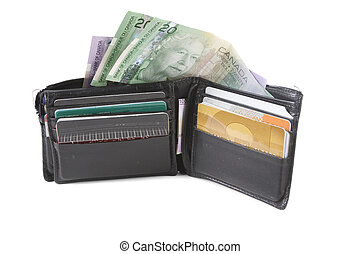 Wallet and money - A worn wallet with credit cards and money