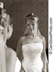 Beautiful bride - The beautiful bride looks at itself in a...