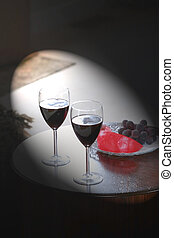 Wine Glass Set Up - Light focusing on two wine glasses and...