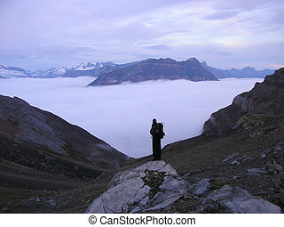 Hiker above clouds - Looking down at the clouds from Hector...