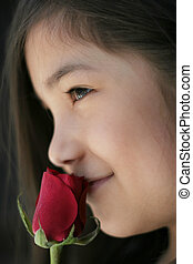 child with rose - Beautiful young girl enjoying the...