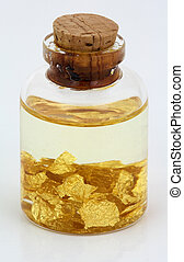 gold sheets inside of a small bottle