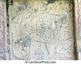 A maya temple stone carving, Chichen Itza, Mexico - A maya...