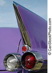 lilac tail fin and rear lights on a classic american car