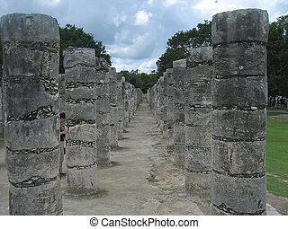 Columns of a maya temple in a walk path, Chichen Itza,...