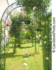 Garden arches and arcades with roses and other flowers,...