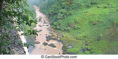 High waterfall in the tropical jungle with a river, Cameroon, Africa, Panorama