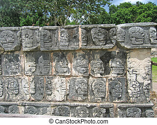 Temple stone sculpture with dead skull forms, Chichen Itza,...