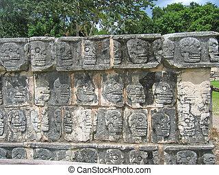 Temple stone sculpture with dead skull forms, Chichen Itza,...