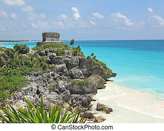 Tropical carabian beach with a maya temple of a top of a...