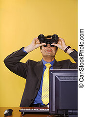 business vision: businessman looking up though binoculars