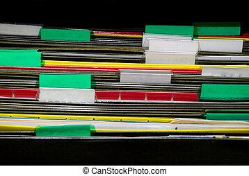 Folders - A set of organized file folders in an office