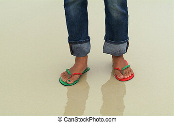 Feet in wet sand - Feet of a woman on a wet beach The right...