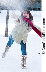 Snowball fight time - I got you - A playful young woman...