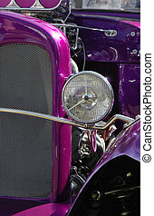 purple hot rod with exposed engine