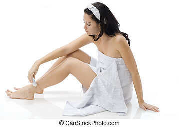 shaver - cute and young brunette dressing white towel...