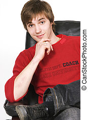 young man portrait - young man sitting on the chair