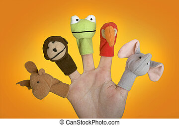 Hand with puppets - Female hand playing with puppets on the...