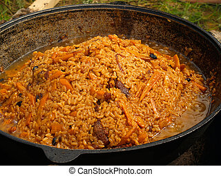 outdoor picnic pilau on the fire