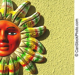 Closeup of Colorful sun - Picture of a clay mayan sun on a...