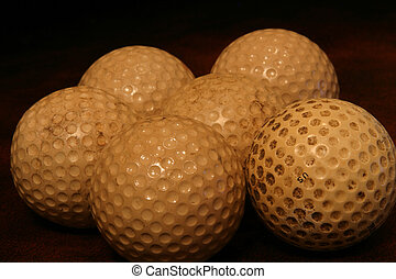 Old Golf Balls - A group of old, worn out, golf balls