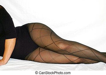 Curves - A woman in a leotard and designer pantyhose over...