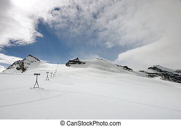 Alpine ski slopes - Ski slopes and a lift in the Swiss alps