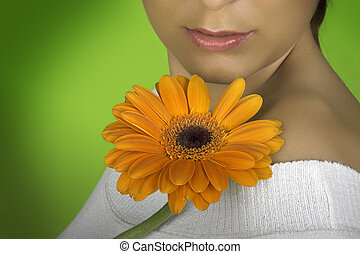 Spring time - Beautiful woman with flowers on a green...