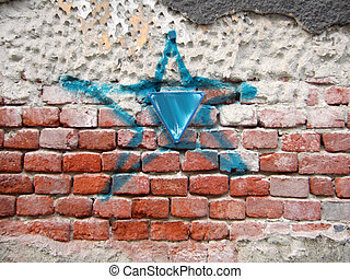 Blue star - Graffiti sign with blue star on red bricks wall