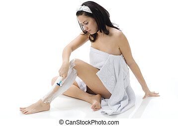 foam - cute and young brunette dressing white towel shaving...