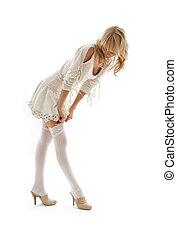 lovely blond dressing up over white