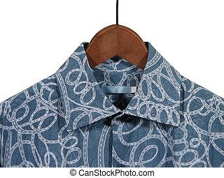 Blue shirt on wooden hanger