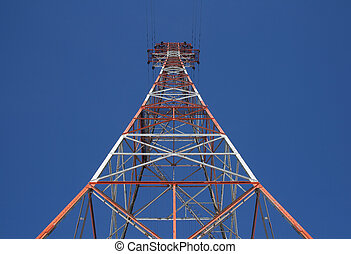 Red triangular power tower in the blue sky