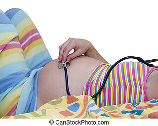 pregnant woman listening for baby with stethoscope belly...