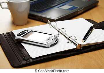Business planning - A PDA and a laptop for planning at the...