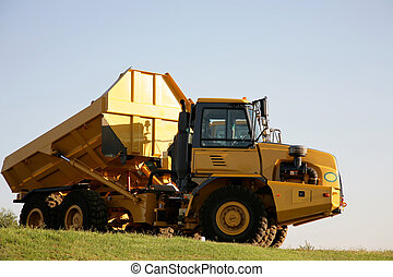 One Truck - A big yellow truck standing outside