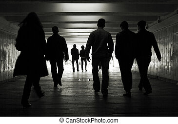 People walk - People silhouettes in a subway tunnel